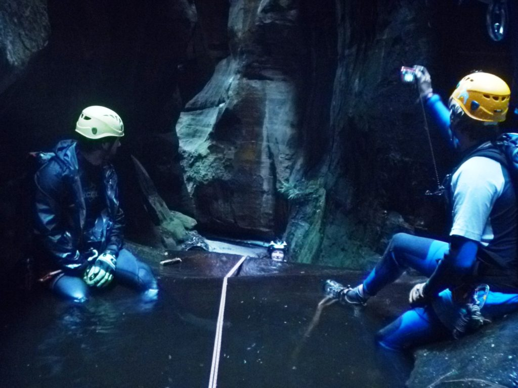 The belay point for the final abseil is a figure 8 on a sling below the pool surface